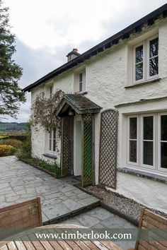 Heritage windows and doors, hand-built in uPVC. Timberlook flush sash windows have traditional features & period character, perfect for conservation areas. Timber Windows, Casement Windows, Sash Windows, Windows And Doors, Cottage Front Doors, Cottage Windows, Lake District Cottages, Rendered Houses, Veranda Ideas