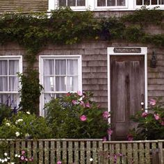 a lichen-encrusted fence complements a rustic cottage garden. this old house. nancy andrews photo
