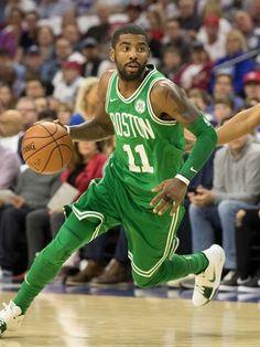 eaa3fa07ed97 Boston Celtics guard Kyrie Irving (11) dribbles past Eastern Conference