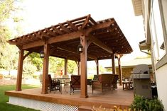 A Western Timber Frame 8000 Series ShadeScape™ DIY pergola kit featuring a cantilever, lattice, full-wrap roof for shade over solid wood deck. Old world craftsmanship with the original innovative Dovetail Difference™ patent-pending design, fast and easy to install. NO nails, NO glue and   UNSIGHTLY hardware. Just beautiful!