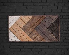 This geometric wood wall art will add a refined touch to the interior at your home. The striking geometric pattern of this reclaimed wood wall hanging will fit seamlessly with any interior due to the natural wood colors! Wooden Wall Art Panels, Wooden Wall Decor, Wood Panel Walls, Panel Wall Art, Diy Wall Art, Large Wall Art, Wood Wall Art, Wood Mosaic, Rustic Wood Walls