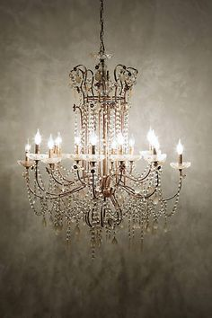 Love this for dining room over farmhouse table. Draped Bijoux Chandelier - anthropologie.com