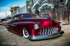 Slammed Chevy red Merc. Chopped and sporting DeSoto grille teeth.