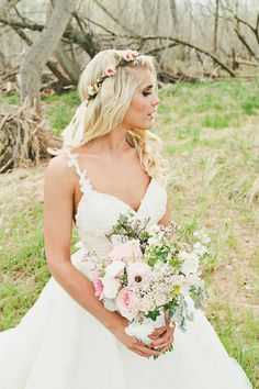 super pretty wedding dress perfect for any princess #watters #weddingdress #pinkbouquet #floralcrown http://www.weddingchicks.com/2013/11/05/elegant-pink-and-gold-wedding/
