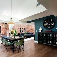 A deep teal makes for a perfect statement wall, especially when paired with a mix of lighter and darker shades -- think teak wood floors and white walls with a black table and buffet. Complement your teal wall with similar blue-green hues in other areas of the room.