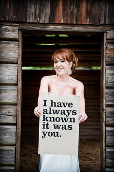 I want this! A photo of the groom holding a sign and also one of the bride!   An even better idea? Customize a sign with something you say to one another so you can always see the picture with the saying!
