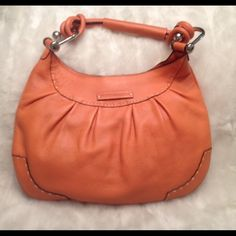 LIKE NEW BCBG MaxAzria Genuine Leather bag Never been used. Inside zipper is still in a wrapper. There's a really small scuff in the leather (spot shown in pic). Clean liner. Measures 10x15 BCBGMaxAzria Bags Shoulder Bags
