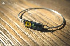 The handmade sterling silver bracelet with a real miniature Sunflower! #TlaliArt