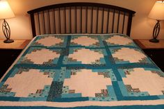 Oversized lap/sofa, blue and white log cabin quilt with a cotton batting.