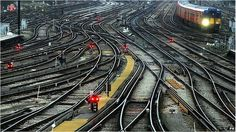 Railway tracks. UK rail passengers 'dissatisfied' with delay information. A third of rail passengers are happy with the way their train company deals with delays or cancellations, a survey has suggested. Passenger Focus's survey said rail customers found Twitter had better information than station staff. #UK #rail #railroad #railway #RailTravel #transport #travel #British #England #GreatBritain #delays