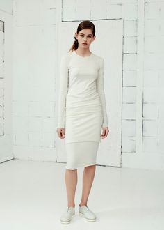 ERIN TOP and SIIRI SKIRT Harmony between comfort, practicality and style is the main concept behind Studio August's design process. This off white longsleeve top with raw hem and skirt have a clean look that evokes a modern, youthful ease. In merino wool fabric, they work as an understated top and skirt or serve as a smooth base to build upon. fashion; style; top; skirt; white; cotton; organic; minimalism; womenswear