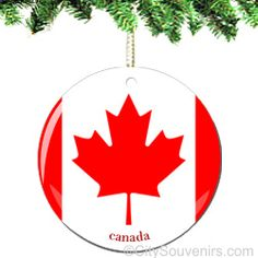 """Porcelain Canada Ornament    Exclusive!  The charm and beauty of Canada is captured in this new and original ornament. The iconic Canadian flag has never looked so glorious.      NYCwebStore.com is proud to offer you these double sided Canadian Christmas ornaments.  We are sure they will be cherished in your family for generations.     Measures 2.75"""" Round   http://www.nycwebstore.com/detail.aspx?PRODUCT_ID=AN-CAPO"""