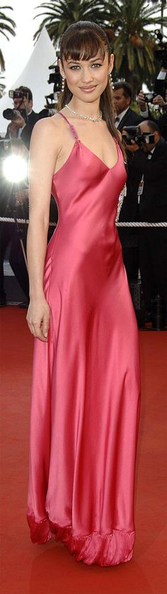 Olga Kurylenko again looks stunning in this pink floor length prom gown.  Then again she could make anything look amazing.  The dress is simply the icing on the cake.
