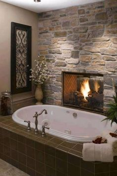 awesome bathroom | Awesome bathroom. | My Dream Home --- would be great if the fireplace was through to the master bedroom. Gorgeous.