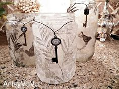 Beautiful!  Pickle jars crafted into votive candle holders.