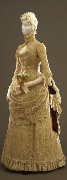 Walking dress in two parts (jacket and skirt), by Atelier A. Felix, Paris, c. 1884, at the Pitti Palace Costume Gallery. Via Europeana Fashion.