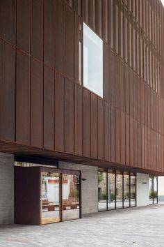 Windows punctuate the perforated-steel facade of this music school in Spain. Technical Architect, Facade Pattern, Floor Slab, Spanish Towns, Weathering Steel, Building A Porch, Perforated Metal, Music School, Small Buildings
