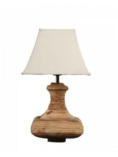 Wood table lamp with simple item and which features an antique finished that's handmade applied in layers to bring out the natural grain and markings.