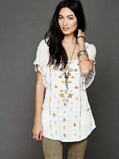 Embroidered tunic top with short flutter sleeves and two front pockets. Gauzy cotton feel. Boxy neckline in front. $89.95 by Free People