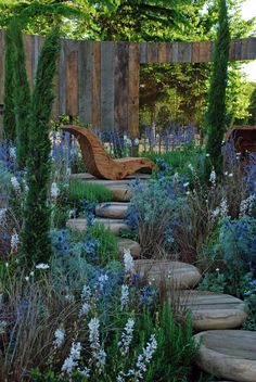 Hampton Court Flower Show 2013: Reclaimed timber fence, stepping stones and lounger // Mike Harvey,