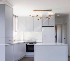 Luxury is embodied through statement lighting and soft hues in this project by Meir champagne tapware adds a bespoke touch to the space. Kitchen Island Lighting, Shop Lighting, News Design, Decoration, Layout Design, Chrome, Ceiling Lights, Space, Luxury