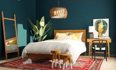 Teal walls + natural woods + bold red rug = the perfect bedroom retreat.⁠ Tight on space? Skip the nightstand and go for a mini desk… Light Teal Bedrooms, Teal Bedroom Walls, Dark Teal Bedroom, Jewel Tone Bedroom, Blue Green Bedrooms, Green Master Bedroom, Green Accent Walls, Teal Walls, Green Rooms