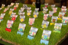 #Soccer #party decorations - creative grass escort card table teams.   We got a real kick out of designing this soccer themed party at Brae Burn Country Club!  We brought new dimensions to the celebration with tall centerpieces that created two levels of decor for the table. Each table represented a different country with a killer soccer team, as did the seating cards found nestled in grass at the escort card table. http://xquisitevents.com/gallery/gallery-sweet-16-mitzvahs/