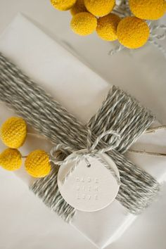 gift wrap.  Love the thickly clustered baker's twine and the billy ball flowers.