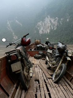 Motorcycles transported across water.