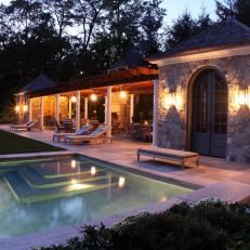 Swimming Pool at Dusk With Lit Lanterns