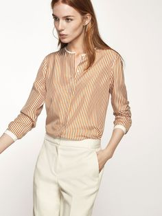 Striped shirt made from 100% mulberry silk fabric with contrasting cuffs and collar detail. Straight cut, round collar, concealed front button fastening and long sleeves with buttoned cuffs.