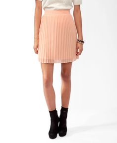This is an example of a knife pleated shirt which has many small pleats all around the skirt.