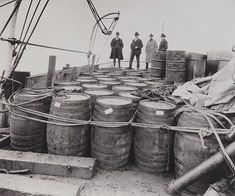 Prohibition agents examine liquor confiscated from a captured rum runner 1924 Source: Library of Congress, Prints and Photographs Division Prohibition 1920, Alcohol Prohibition, 21st Amendment, Library Of Congress, Coast Guard, Old Antiques, Mug Shots, Fast Cars, Liquor