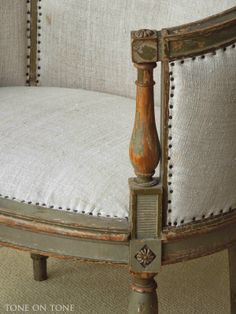 from Tone on Tone. Nice color, simple linen fabric, nailhead trim.