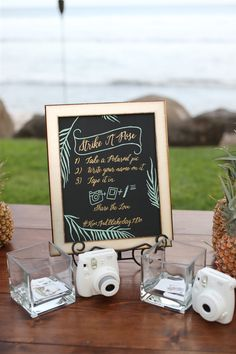 Welcome table with vintage suitcase card holder photo guest book diy polaroid photo booth solutioingenieria Image collections