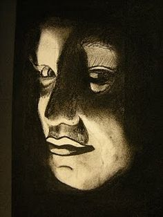 charcoal self portraits with flashlight under the chin in a dim classroom (good replacement to xerox)