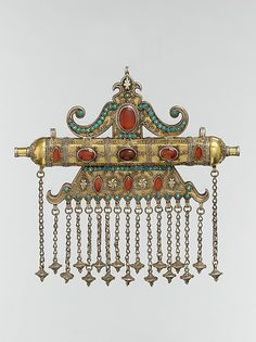 Present day Uzbekistan, Karakalpak | Triangular Amulet Holder from the late 19th to early 20th century | Silver, fire-gilded, with stamped beading, silver shot, decorative wire, gilt and silver applied decoration, loop-in-loop chains, cone-shaped pendants, slightly domed and cabochon carnelians, and turquoise beads
