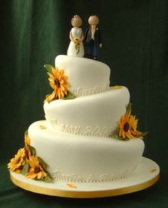 Scuplted cake decorated with sunflowers