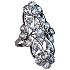 Antique French Long Diamond Ring. Circa 1915  Of an ornate openwork design, crafted in platinum and 18K gold, set with old European and cushion cut diamonds.  Total estimated diamond weight 2.35 ct. Marked with dog's head French platinum mark.