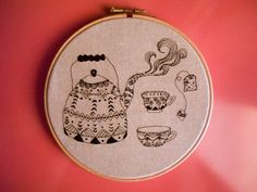 Even the hardest answers of life swim in a tea cup...***  This is an embroidered tea set illustration, original drawing of mine, made while drinking my favorite green tea with lemon & ginger! This cozy teapot woth its two mugs can be a great gift to yourself or your tea buddy! It is embroidered on a high quality brownish-grey cotton fabric and stretched on a 7 inch wooden embroidery hoop, using one black thread. On the back side it is finished with felt fabric. All items are made in a…