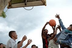 Youth in the rural mountain village of Balani play basketball with new ball provided by Scandinavian sponsors of Plan International. Balani, Philippines.