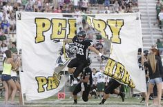 The Perry Panthers take the field for their game against Central Catholic in week two of the high school football season.