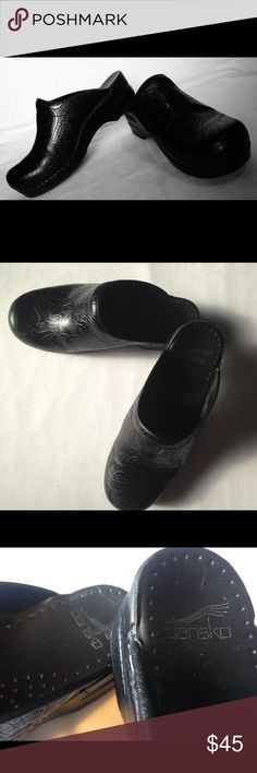 Black Dansko clogs Dansko clogs with beautiful and unique vines and flores design embellished in the leather. Gently loved and in great shape. Dansko Shoes Mules & Clogs