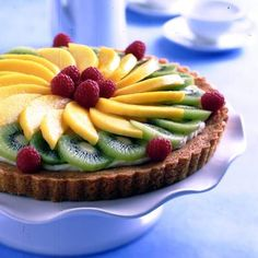 Spring Fruit Tart | Meals.com - Celebrate the sweetness of spring with this stunning tart, bursting with the flavor of fresh, seasonal fruit.
