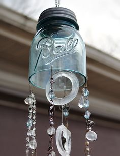 Turn vintage or decorative canning jars into charming pieces of glass art with this wonderful mason jar wind chimes tutorial!