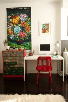 Great use of color and print on the wall for a home office space.