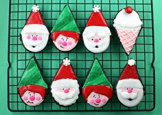 Jolly Santa and his elves! Cookie decorated using the ice cream cone cutter! Thanks Bakerella!