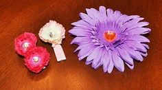 Tutorial: 10 Minute Flower Clip  I have been seeing silk flower hair clips all over the place. I wanted to make one for myself and one for my daughter. Since my daughter is only a year and a half, I decided to make her a mini flower clip. I ended up making two for her since I couldn't decide if I wanted one or two flowers on a clip. I made the big purple one for myself.            Supplies    Flower   Rhinestone  Ribbon (I used 3/8 inch ribbon)  Hair Clip   Hot Glue Gun and Glue…