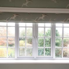 Sanderson Swallows for this bespoke roman blind. Elegant country style for this Master Bedroom.