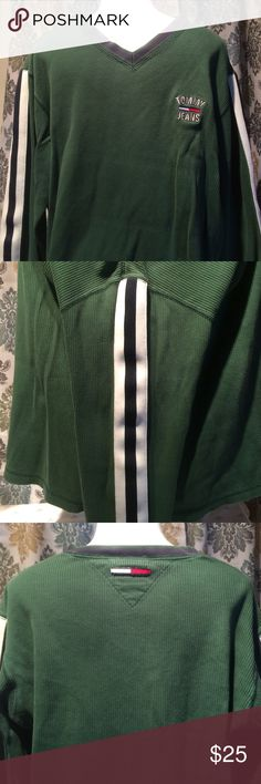 Tommy jeans sweatshirt Tommy jeans heavy sweatshirt. It's dark green with black & white stripes going down the sleeves. Front shows tommy jeans logo & the back also has the logo for tommy jeans. Tommy Hilfiger Sweaters V-Neck